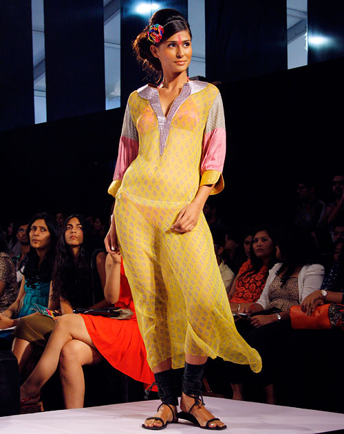 A model wears a pale yellow Anupama Dayal creation