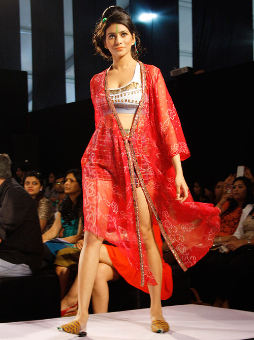 A model shows off a red printed jacket by Anupama Dayal