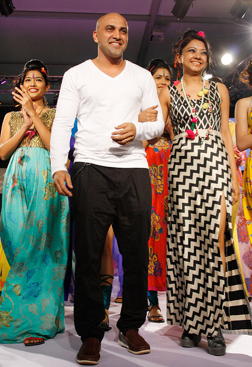 Sherrin Varghese walks the ramp with Anupama Dayal