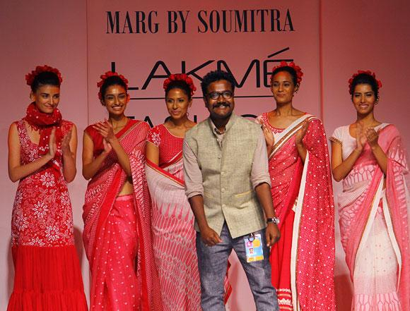 Soumitra Mondol appears on the runway to take a bow as his models and audience break into a round of applause.
