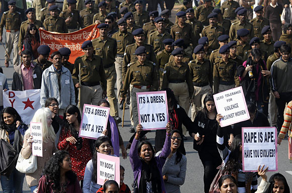 Demonstrators shout slogans during a protest organised by women's organisations in New Delhi, December 21, 2012.