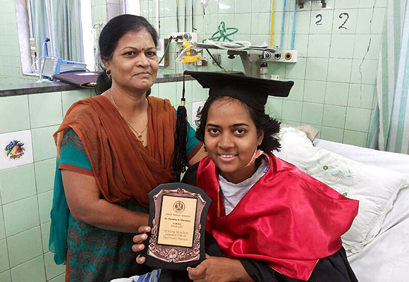 Samidha Khandare with her MBBS degree, which she received in a medical ward at  Sion Hospital, Mumbai in February this year; to the left is her mother Jayashree
