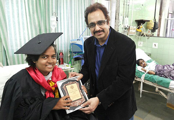 Samidha Khandare receives her MBBS degree from Dr Suleiman Merchant, former dean of Sion Hospital, in February 2013