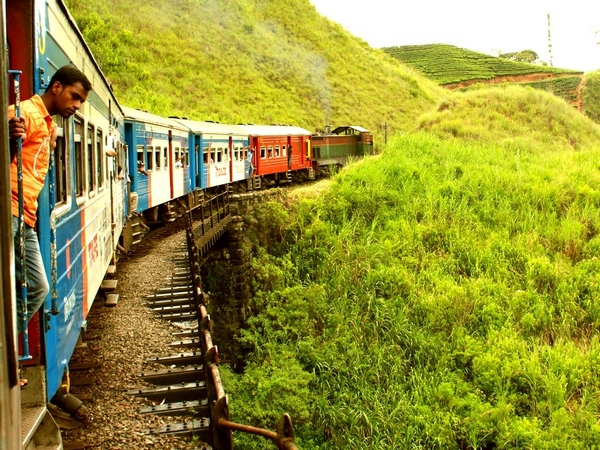 Take the train to Kandy at least one way.