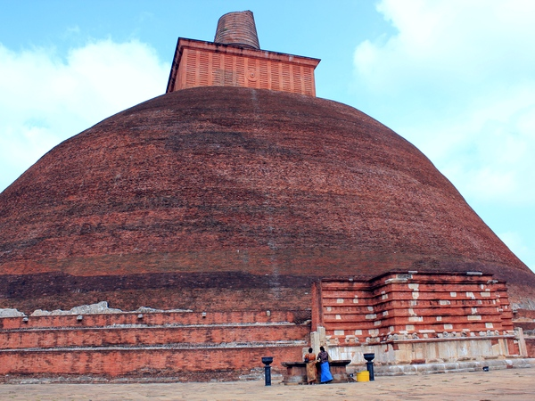 An ancient stupa towers over the ruins of Anuradhapura