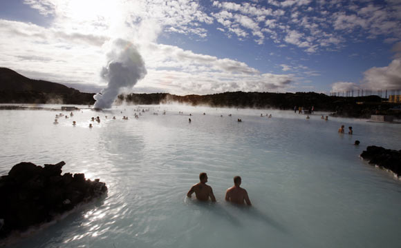 Bathers swim in the geothermal hot springs at Iceland's Blue Lagoon near Grindavik. The blue colour of the water is caused by minerals and a blue green algae.