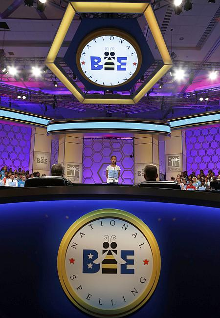 A competitor participates in the 2013 Scripps National Spelling Bee at the Gaylord National Resort and Convention Center at National Harbor in Maryland, May 29, 2013.