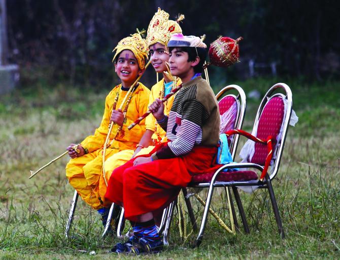 : Kashmiri children dressed as Lord Rama, Lakshman and Hanuman in Srinagar
