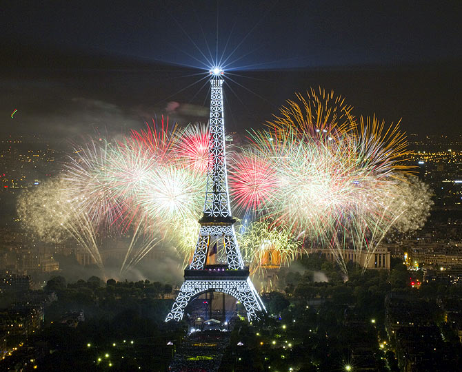 The Eiffel Tower is illuminated during the traditional Bastille Day fireworks display in Paris, France