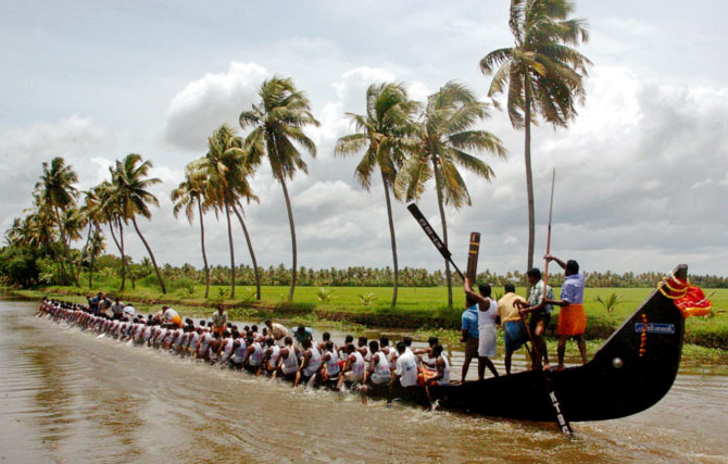 Indian oarsmen row their boat during a practice session for upcoming Nehru boat race in Alleppy district in Kerala