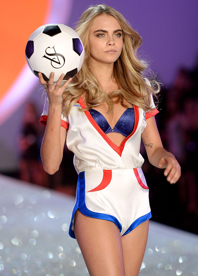 Model Cara Delevingne walks the runway at the 2013 Victoria's Secret Fashion Show at Lexington Avenue Armory in New York City.