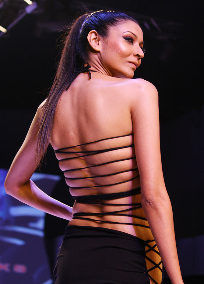 Too hot to handle? Models in slinky, revealing outfits!