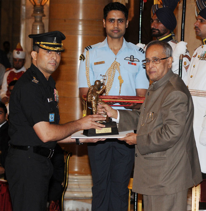 The President, Pranab Mukherjee presenting the Tenzing Norgay National Adventure Award-2012 to Major Ranveer Singh Jamwal for Mountaineering, at the National Sports & Adventure awards ceremony, at Rashtrapati Bhawan, in New Delhi on August 31, 2013.