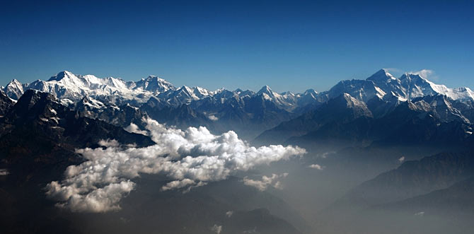 Mount Everest (2nd R), the world highest peak, and other peaks of the Himalayan range are seen from air during a mountain flight from Kathmandu