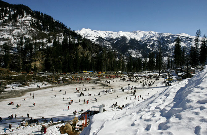 Tourists ski in Solang Valley in Himachal Pradesh.
