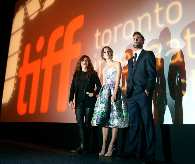 Keira Knightley, Cahtherine Keener (L) and Adam Levine (R) are introduced on stage at the premiere of Can a Song Save Your Life? at the 38th Toronto International Film Festival in Toronto.