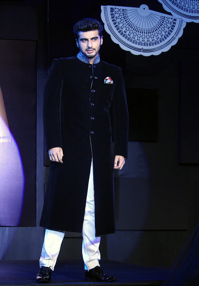The royal look is in. Go for Sherwani-style suits. Stick to monochrome quite like Arjun Kapoor.