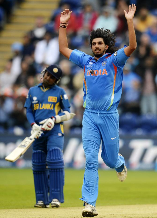 India's Ishant Sharma (R) celebrates after dismissing Sri Lanka's Kumar Sangakkara (not pictured) as Sri Lanka's Mahela Jayawardene looks on during the ICC Champions Trophy semi-final match at Cardiff Wales Stadium in Wales June 20, 2013.