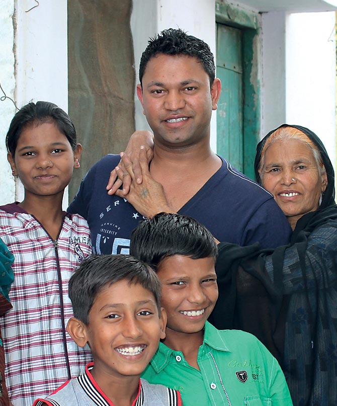 Saroo Brierley reunited with his mother (to his left). Also seen here is his brother Kallu's daughter Norin, his sister Shekila's son Ayan and one of Kallu's sons Shail.