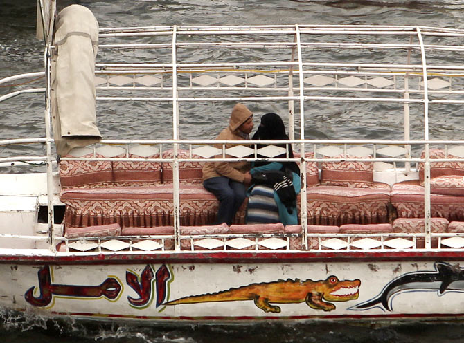 A couple enjoys a faluka (boat) ride on Valentine's Day on river Nile in Cairo, February 14, 2013.