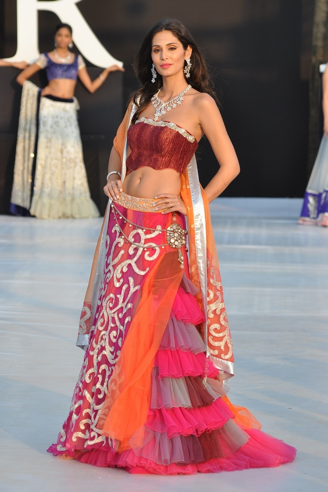 Bruna Abdullah walks the runway at India Resort Fashion Week in Goa in a floor-length anarkali for Shouger Merchant Doshi.