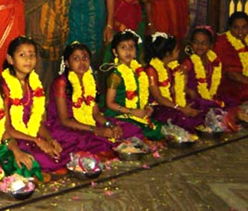 During Kanya Pooja, nine young girls are served food and goodies
