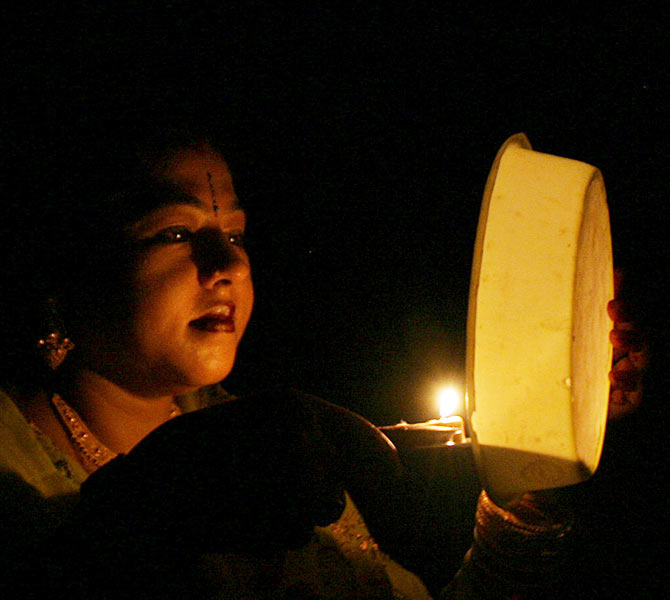 A woman prays during the Hindu festival of Karva Chauth, in the northeastern Indian city of Siliguri