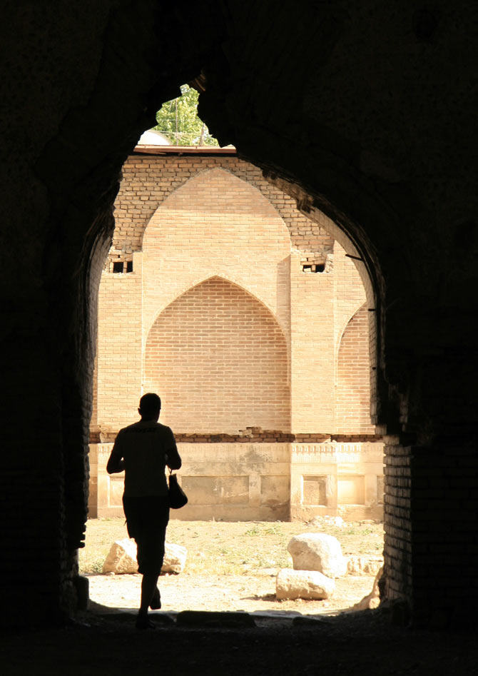 A man walks in Samarkand June 9, 2007. Sitting on the ancient Silk Road trade route which linked China with Imperial Rome, present-day Uzbekistan was once a key regional player which flourished in trade, culture and science.