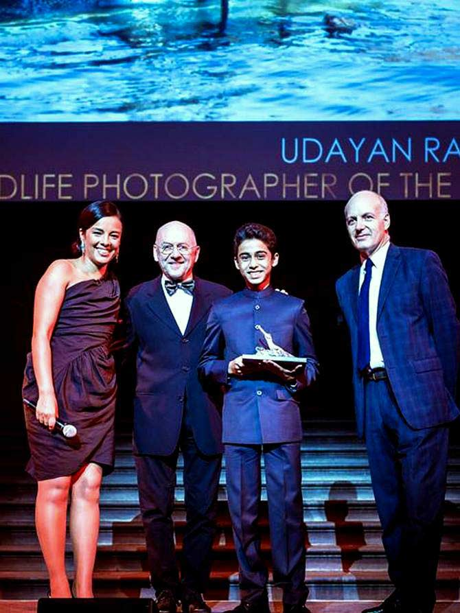 14-year-old Udayan Rao Pawar (third from left) receives the prestigious award from the well-known environmentalist and photographer Jim Brandenburg (second from left) at Britain's Natural History Museum in London.