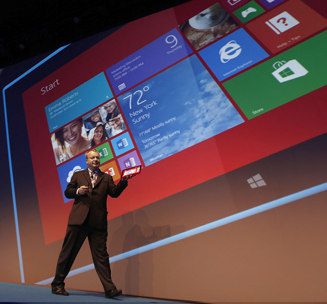 Nokia's former chief executive and the company's head of devices, Stephen Elop, displays the Lumia 2520 tablet.