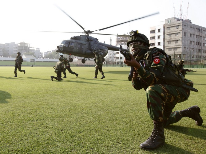 A file picture of army personnel taking part in a mock emergency drill after a controlled blast at a stadium in Dhaka.