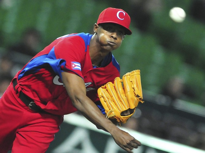 A file picture of Cuba's Raciel Iglesias as he pitches a ball during the last preparation game for the World Baseball Classic (WBC) in Fukuoka, Japan