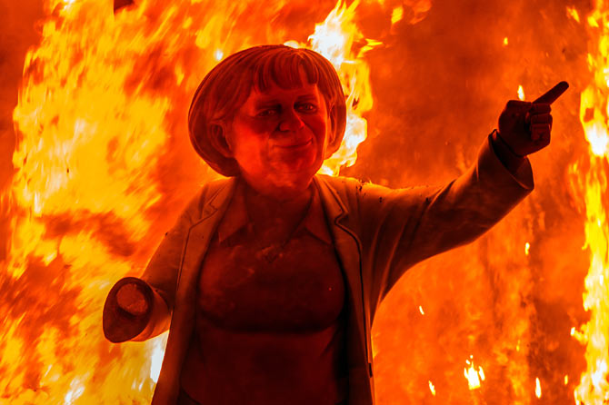 A ninot of German Chancellor Angela Merkel being set ablaze during Las Fallas