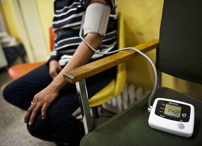 According to Jain, 35 per cent of people who suffer from high blood pressure don't even know it. Seen here is a patient getting her blood pressure checked at a clinic.