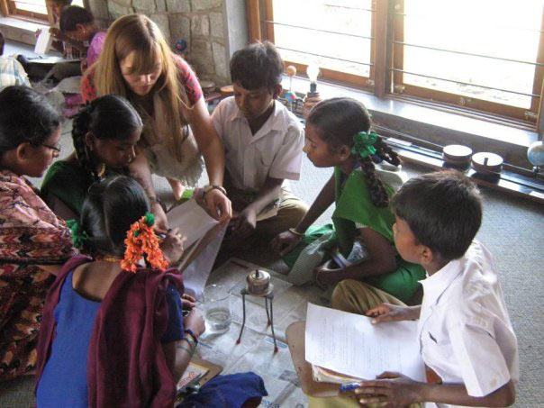 Deshpande Foundation's Sandbox Fellow interacts with children from a rural Indian school