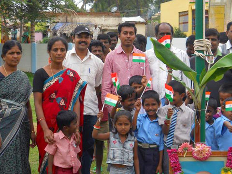 Santosh poses with kids and teachers from a local school in Bangalore