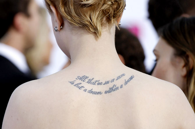 Actress Evan Rachel Wood's tattoo at the back of her neck reads 'All that we see or seem is but a dream within a dream'.