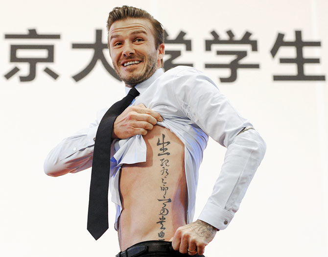 David Beckham's tattoo in Chinese characters reads, 'Life and death are determined by fate, rank and riches decreed by Heaven'.