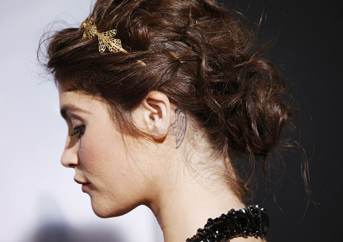 Gemma Arterton has an angel wing tattoo etched behind her ear.
