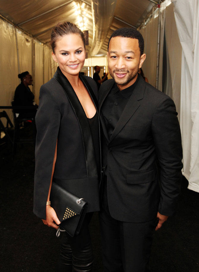 Model Chrissy Teigen and John Legend pose outside the Samsung Galaxy Lounge at Mercedes-Benz Fashion Week Spring 2014 Collections at Lincoln Center on September 10, 2013 in New York City.