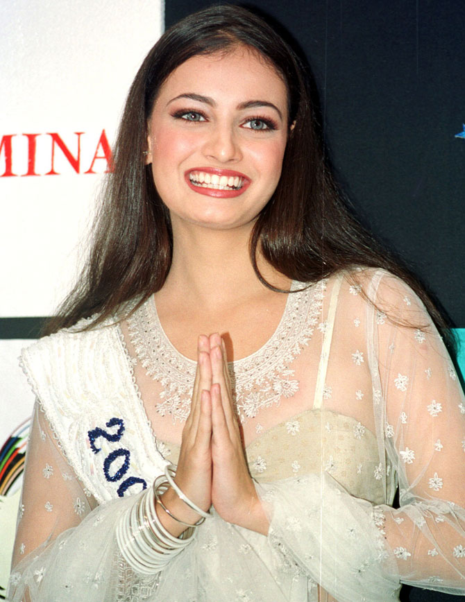 Diya Mirza, Miss Asia Pacific, folds her hands in traditional Indian style of greeting upon her arrival in the western Indian city of Bombay on December 14, 2000.