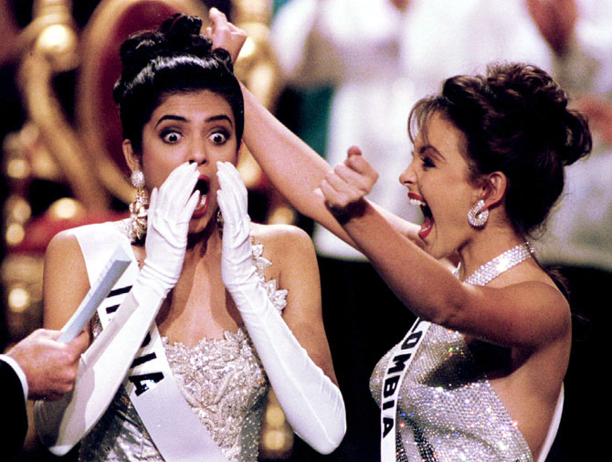 Miss India Sushmita Sen reacts after winning the Miss Universe beauty pageant in Manila May 21. At right jubilating is first runner up Miss Colombia Carolina Gomez