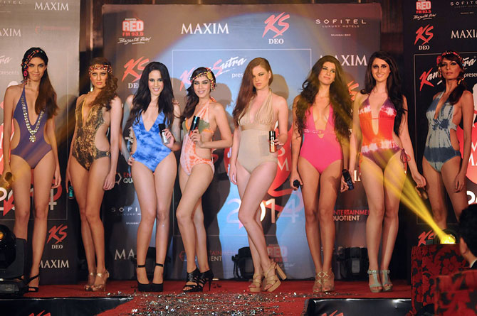 Down, boys! Monica Dogra at a swimwear fashion show
