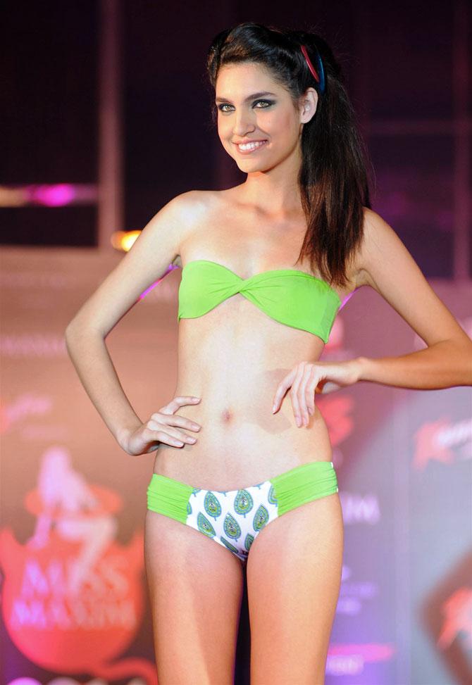 Down, boys! Monica Dogra at a swimwear fashion show