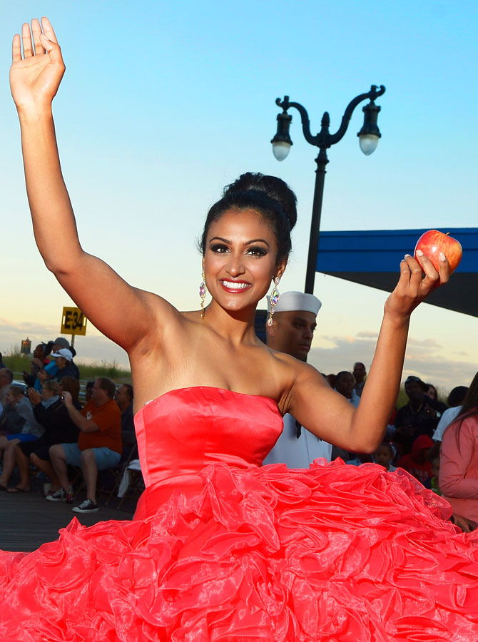 Miss America 2014 contestant Miss New York Nina Davuluri appears in the 2014 Miss America Competition Parade at Boardwalk Hall Arena on September 14, 2013 in Atlantic City, New Jersey