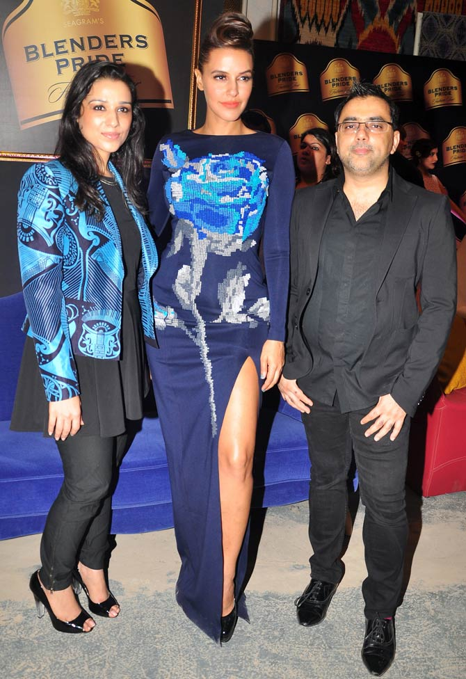 Neha Dhupia is flanked by Nidhi (L) and Pankaj