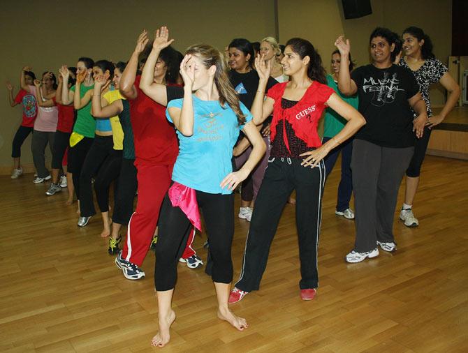 Take a cardio group class like Masala Bhangra