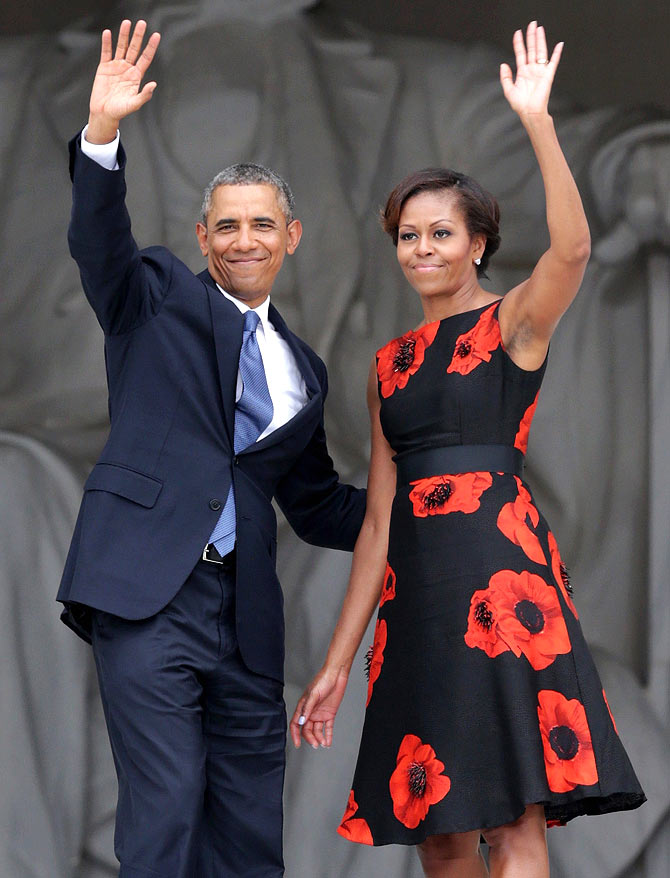 U.S. President Barack Obama (L) and first lady Michelle Obama wave as they leave at the end of the Let Freedom Ring ceremony at the Lincoln Memorial August 28, 2013 in Washington, DC. The event was to commemorate the 50th anniversary of Dr. Martin Luther King Jr.'s I Have a Dream speech and the March on Washington for Jobs and Freedom.