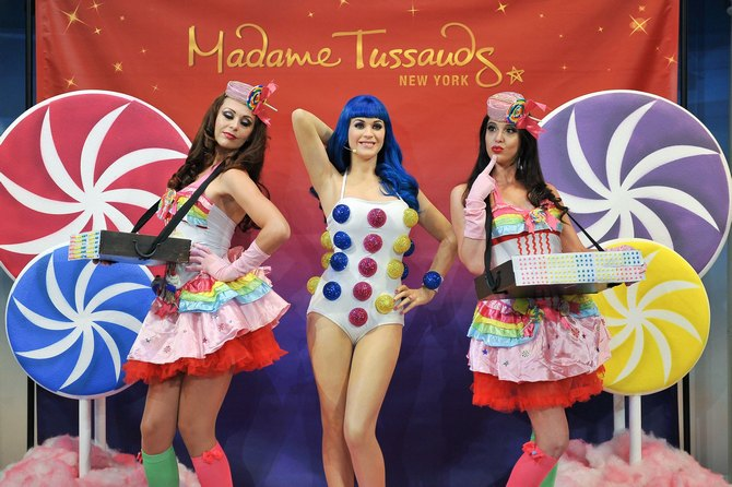 Is this for real? Usherettes pose with a new wax figure of Katy Perry unveiled at Madame Tussauds, New York City.