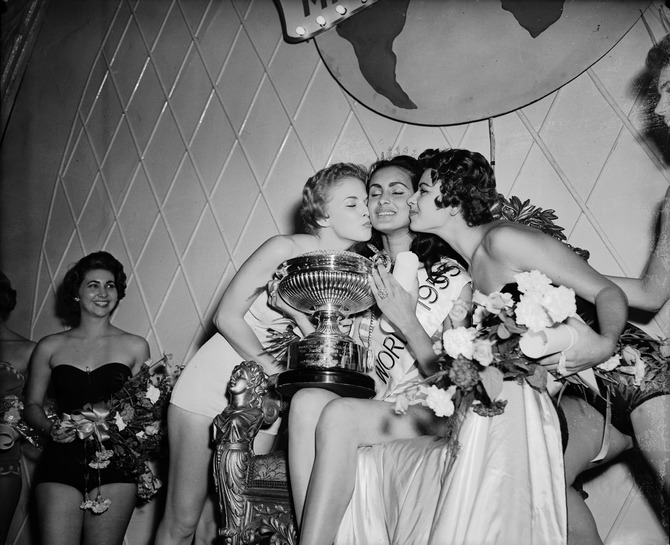 Carmen Susana Duijm Zubillaga of Venezuela after being crowned Miss World 1955 at the Lyceum Ballroom, London, 21st October 1955. First runner-up Margaret Anne Haywood of the USA can be seen on the left.